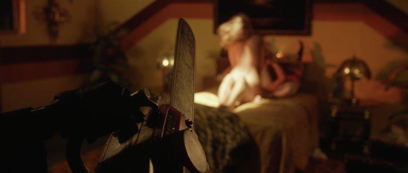 szaleniec atakuje parę uprawiająca seks piłą mechaniczną - recenzja filmu The Editor